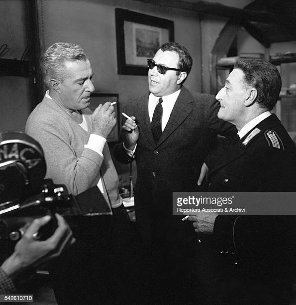 Italian actor Tot˜ Italian actor and director Vittorio De Sica and Italian director Sergio Corbucci smoking on the set of The Two Marshals 1961