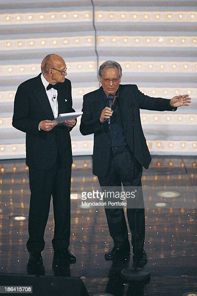 Italian actor TV presenter and scenarist Raimondo Vianello introducing Italian singersongwriter standup comedian and actor Enzo Jannacci at the 48th...