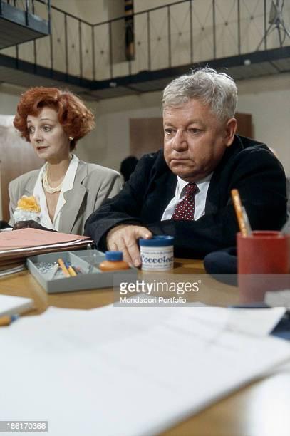Italian actor writer and comedian Paolo Villaggio sitting beside Italian actress Milena Vukotic in the film Fantozzi alla riscossa Italy 1990