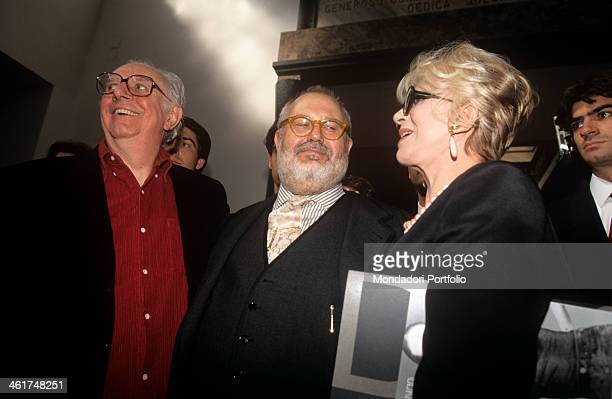 Italian actorplaywright Dario Fo and his wife and colleague Franca Rame taken alongside the fashion designer Gianfranco Ferré in the occasion of a...