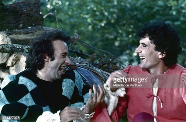 Italian actors and directors Massimo Troisi and Roberto Benigni having fun on the set of the film Non ci resta che piangere 1984