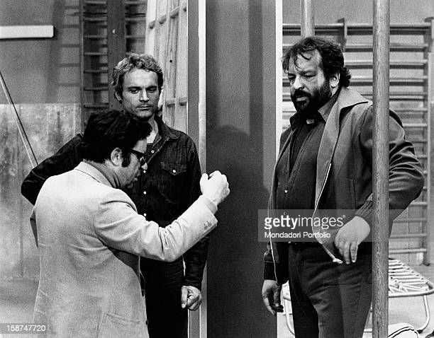 Italian actors Bud Spencer and Terence Hill listening to Italian director Marcello Fondato on the set of the film Watch Out We're Mad Rome 1974