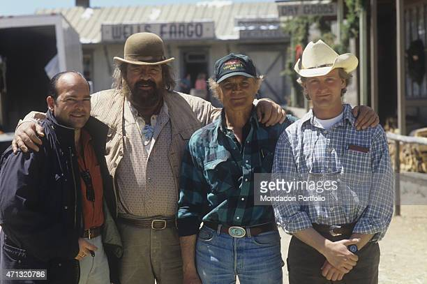 Italian actors Bud Spencer and Terence Hill posing on the set of the film Troublemakers with their sons Giuseppe Pedersoli and Jess Hill Santa Fe 1994
