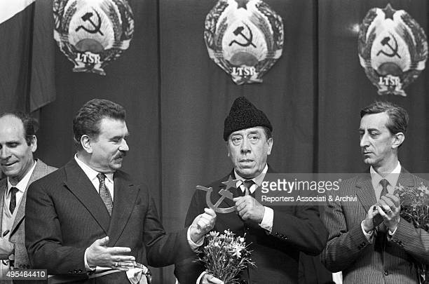 Italian actors Gino Cervi giving the hammer and sickle symbol to French actor Fernandel in the film Don Camillo in Moscow 1965