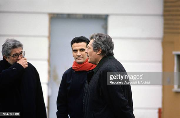 Italian actors Marcello Mastroianni and Massimo Troisi and Italian director Ettore Scola having a break on the set of the film What Time Is It 1989