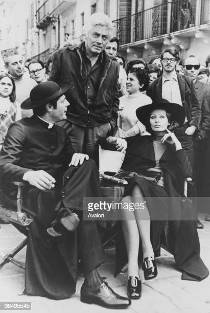 Italian actors Marcello Mastroianni and Sophia Loren on the set of 'La Moglie del Prete' in Rome 25th February 1971 Standing between them is the...
