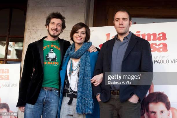 Italian actors Paolo Ruffini Claudia Pandolfi and Valerio Mastandrea attend 'La Prima Cosa Bella' photocall at Embassy Cinema on January 12 2010 in...