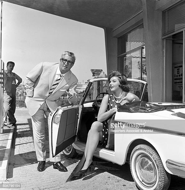 Italian actors Sylva Koscina and Mario Carotenuto posing in a car Italy 1960