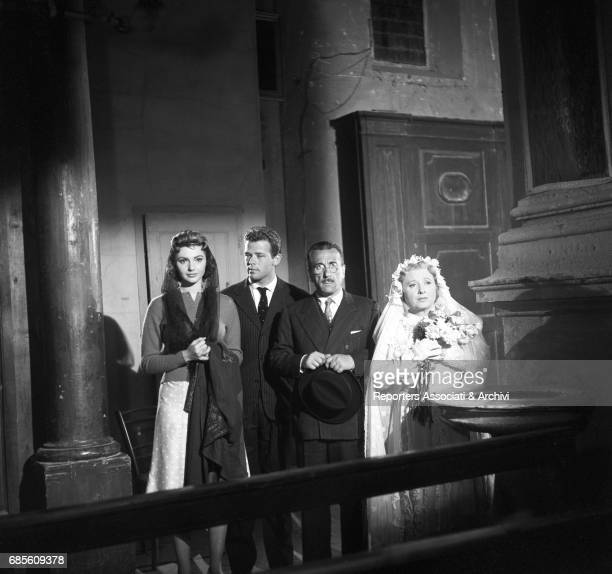 Italian actors Sylva Koscina Renato Salvatori Peppino De Filippo and Dolores Palumbo in a church in La nonna Sabella 1957
