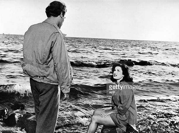 Italian actors Vincenzo Musolino and Silvana Pampanini are pictured during the shooting of the film 'Noi Cannibali' at an unknown location in 1953...