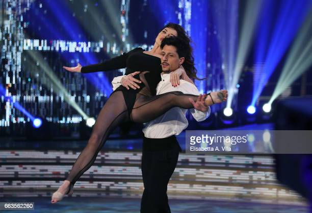 Italian actress Alba Parietti and her dance partner Marcello Nuzio perform on the Italian TV show 'Ballando Con Le Stelle' at Auditorium Rai on April...
