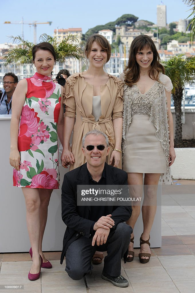 Italian actress Alina Berzenteanu, Italian actress Isabella Ragonese, Italian actress Stefania Montorsi and Italian director Daniele Luchetti (bottom) pose during the photocall of 'La Nostra Vita' (Our Life) presented in competition at the 63rd Cannes Film Festival on May 20, 2010 in Cannes.