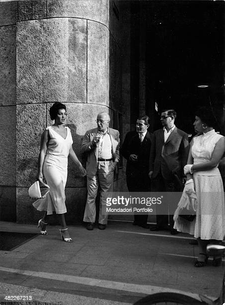 Italian actress and circus owner Moira Orfei walking under the admiring eyes of passersby Milan 1953