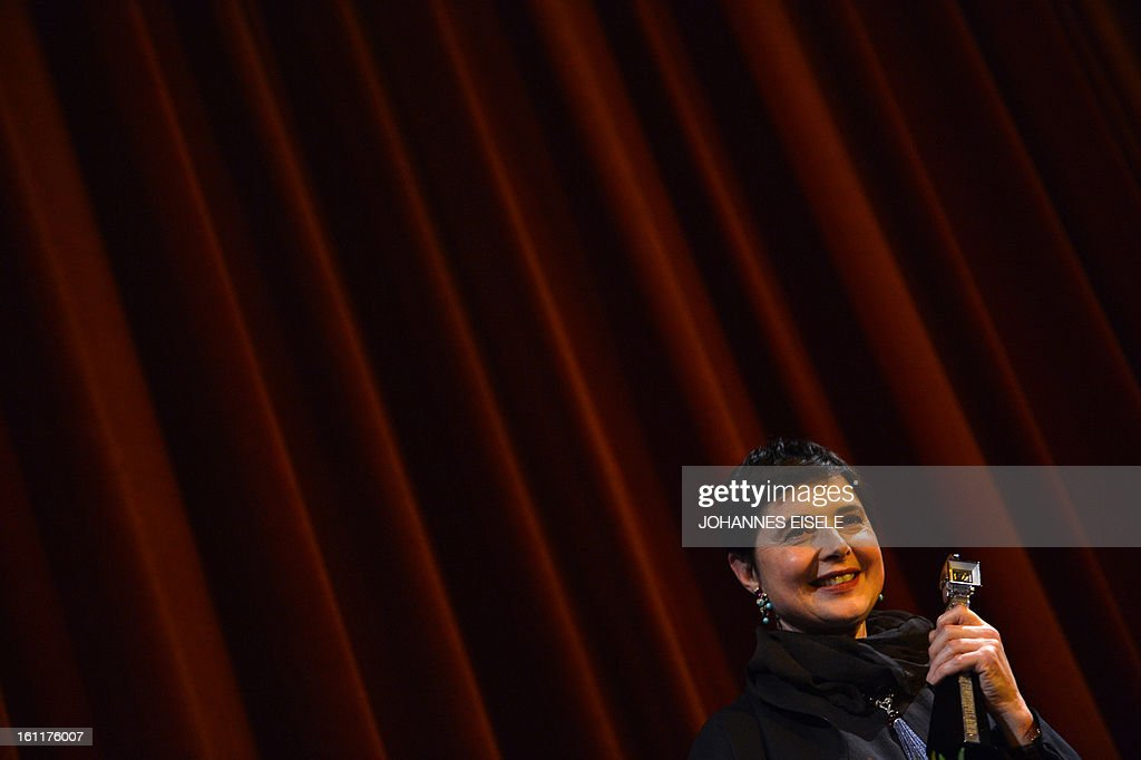 Italian actress and filmmaker Isabella Rossellini holds her trophy after being awarded the Berlinale Kamera during the 63rd Berlin International Film Festival in Berlin on February 9, 2013.