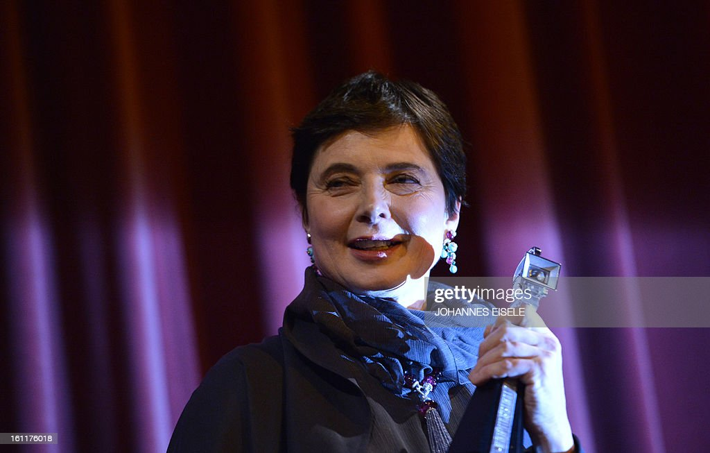 Italian actress and filmmaker Isabella Rossellini holds her trophy after being awarded the Berlinale Kamera during the 63rd Berlin International Film Festival in Berlin on February 9, 2013. AFP PHOTO / JOHANNES EISELE