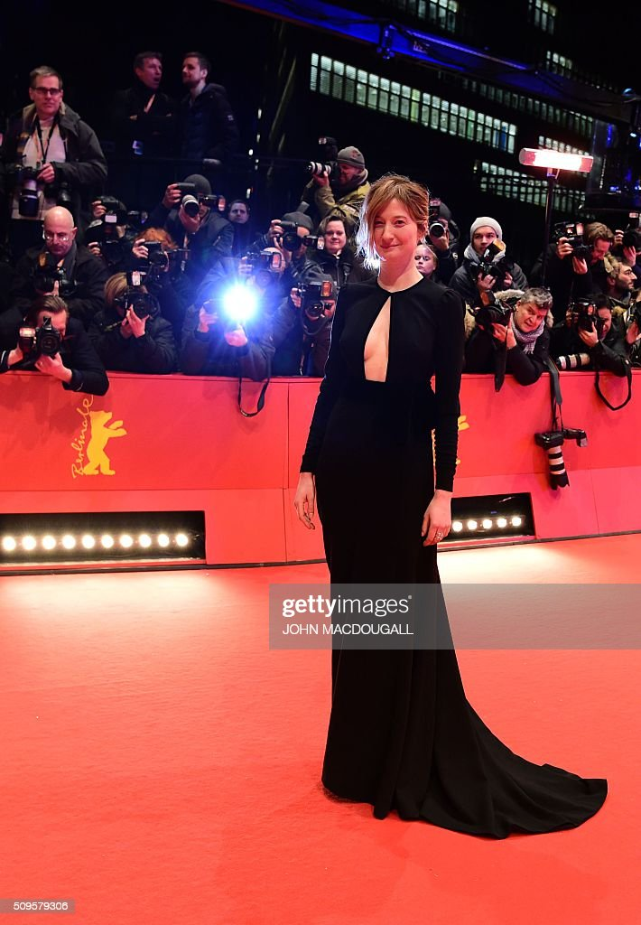 Italian actress and jury member Alba Rohrwacher poses for photographers as he arrives on the red carpet for the film 'Hail, Caesar!' screening as opening film of the 66th Berlinale Film Festival in Berlin on February 11, 2016. Eighteen pictures will vie for the Golden Bear top prize at the event which runs from February 11 to 21, 2016. / AFP / John MACDOUGALL