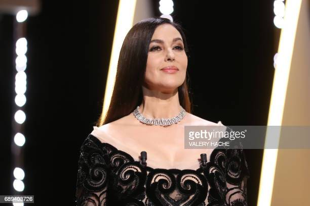 Italian actress and master of ceremonies Monica Bellucci arrives on stage on May 28 2017 during the closing ceremony of the 70th edition of the...