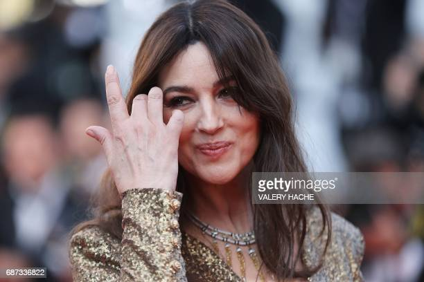 Italian actress and master of ceremonies Monica Bellucci poses as she arrives on May 23 2017 for the '70th Anniversary' ceremony of the Cannes Film...