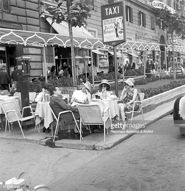 'Italian actress and model Elsa Martinelli at the Caf de Paris on via Veneto with her husband Franco Mancinelli Scotti and two friends Rome 1960 '