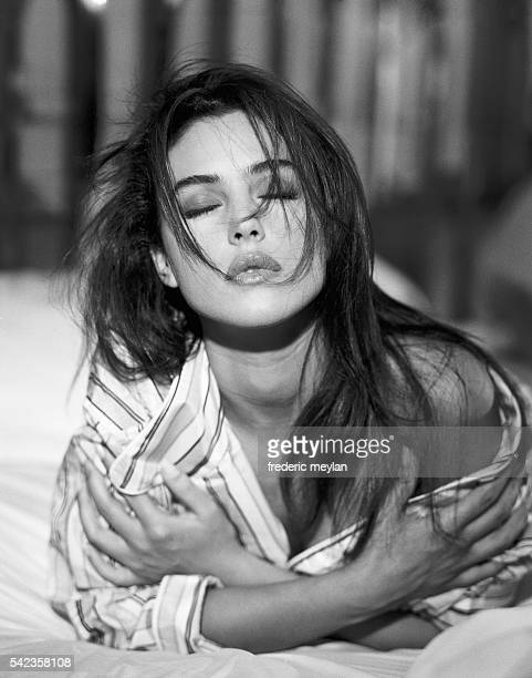Italian actress and model Monica Bellucci wears a pyjama top designed by Lanvin Homme