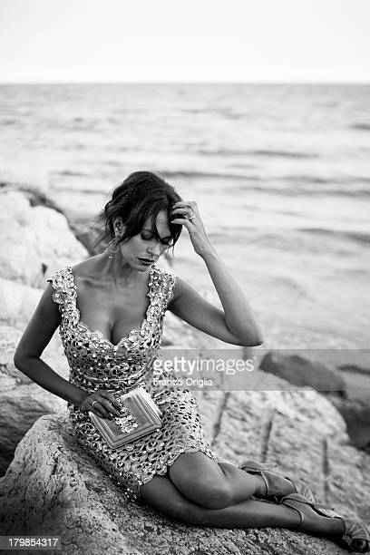 Italian actress and producer Maria Grazia Cucinotta poses for a portrait session as part of the 70th Venice International Film Festival on September...