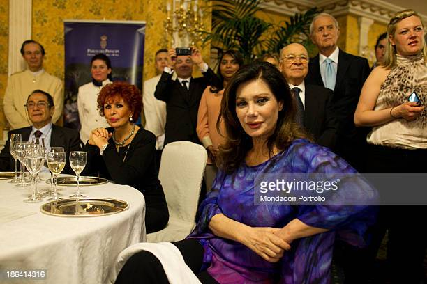 Italian actress and singer Maria Scicolone and Frenchborn Italian actress and producer Edwige Fenech sitting among the guests during the reception at...