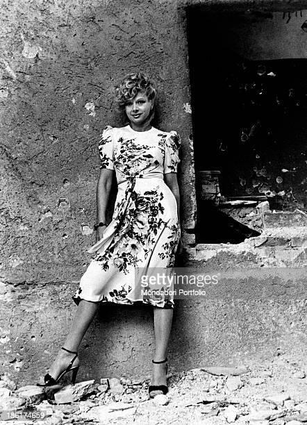 Italian actress and TV presenter Sandra Milo posing in a flowered dress 1978