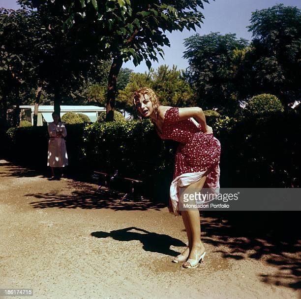 Italian actress and TV presenter Sandra Milo posing in a wet dress Venice 1956