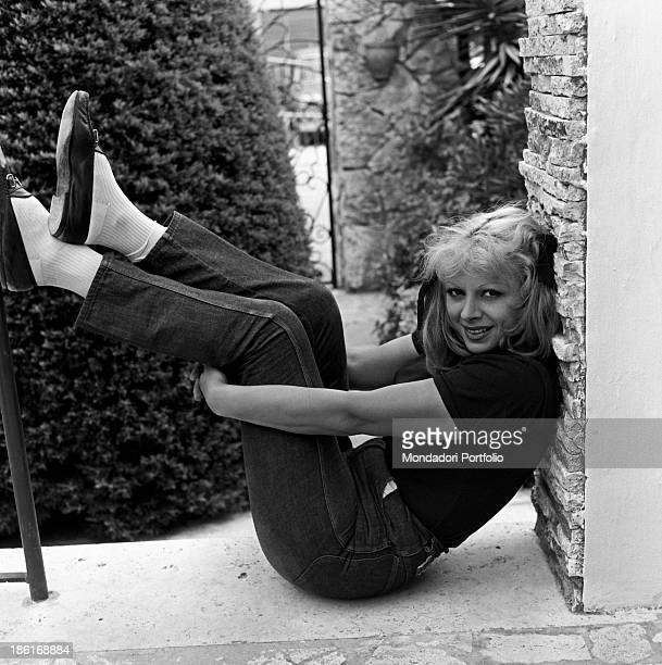 Italian actress and TV presenter Sandra Milo posing in her garden at home wearing a pair of jeans Fregene July 1964