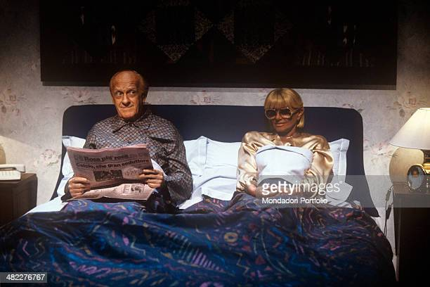 Italian actress and TV presenter Sandra Mondaini in double bed complaining of her boring life with Italian actor and TV host Raimondo Vianello in an...