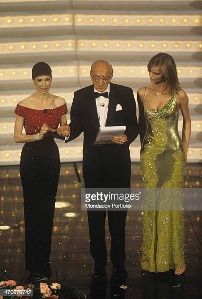 'Italian actress and TV presenter Veronica Pivetti Italian actor and TV host Raimondo Vianello and Czech model Eva Herzigova presenting the 48th...