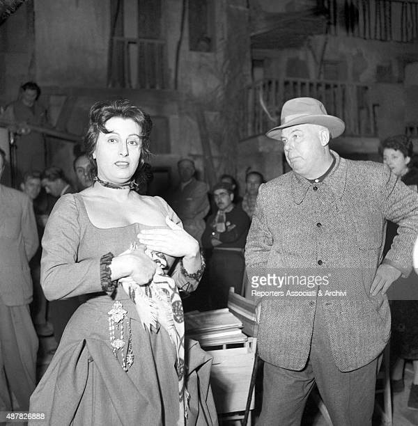 Italian actress Anna Magnani and French director Jean Renoir during a berak in The Golden Coach Italy 1952