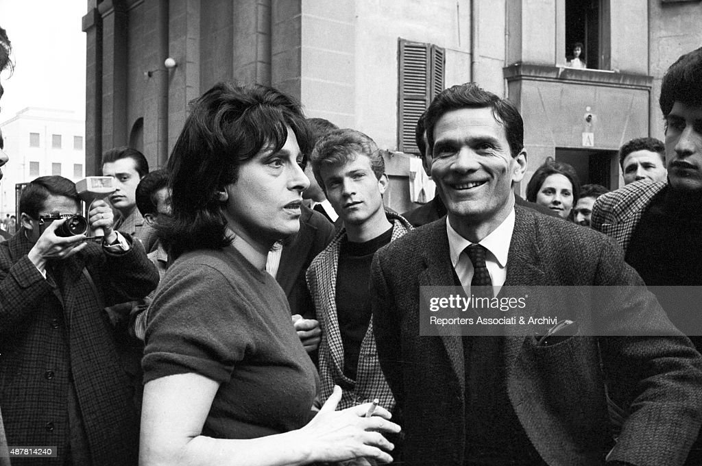 Italian actress Anna Magnani and Italian director writer and poet Pier Paolo Pasolini surrounded by many curious people while shooting the film Mamma...
