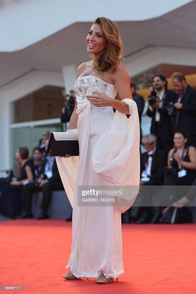 Italian actress Arianna Bergamaschi arrives for the award ceremony of the 70th Venice Film Festival on September 7, 2013 at Venice Lido. AFP PHOTO / GABRIEL BOUYS