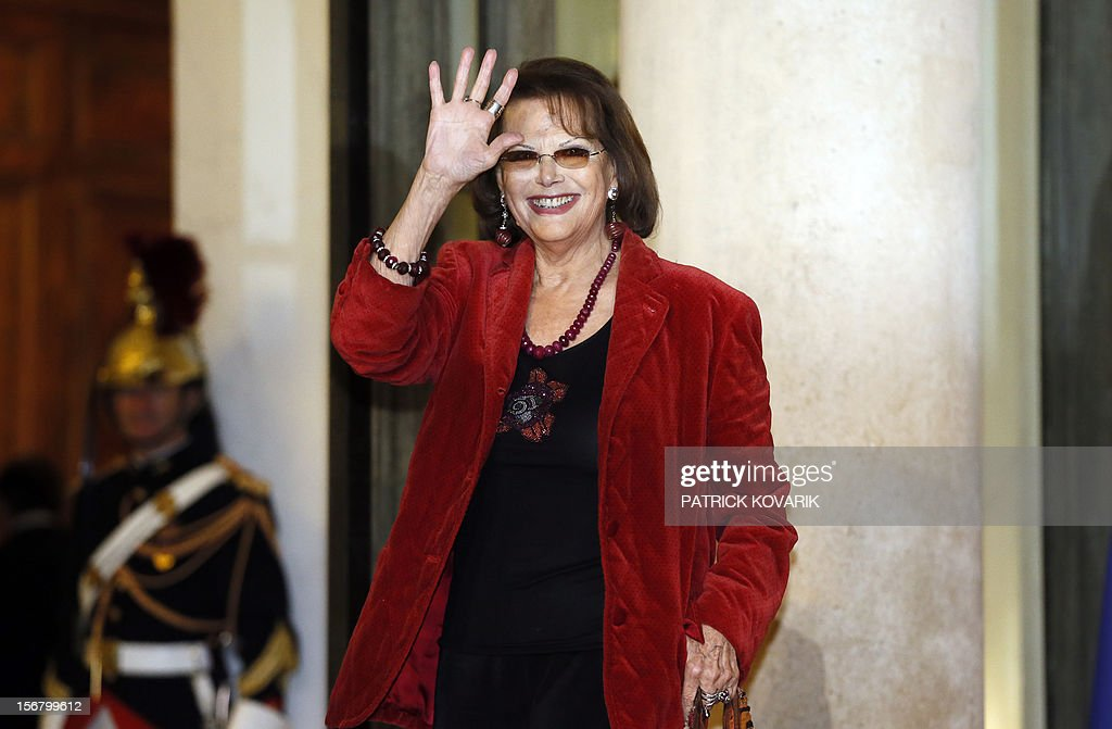 Italian actress Claudia Cardinale arrives at the Elysee palace in Paris, before a state dinner as part of a two-day state visit of Italian President Giorgio Napolitano, on November 21, 2012.