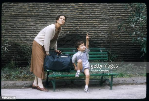 Italian actress Claudia Cardinale looks at the sky as child actor Andrea Spada points upwards in a scene of Italian director Luigi Comencini's film...