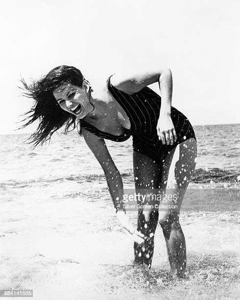 Italian actress Claudia Cardinale on the beach circa 1960