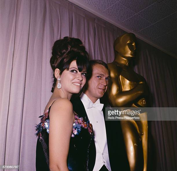 Italian actress Claudia Cardinale pictured with American actor Steve McQueen at the 37th Academy Awards or Oscars at the Santa Monica Civic...