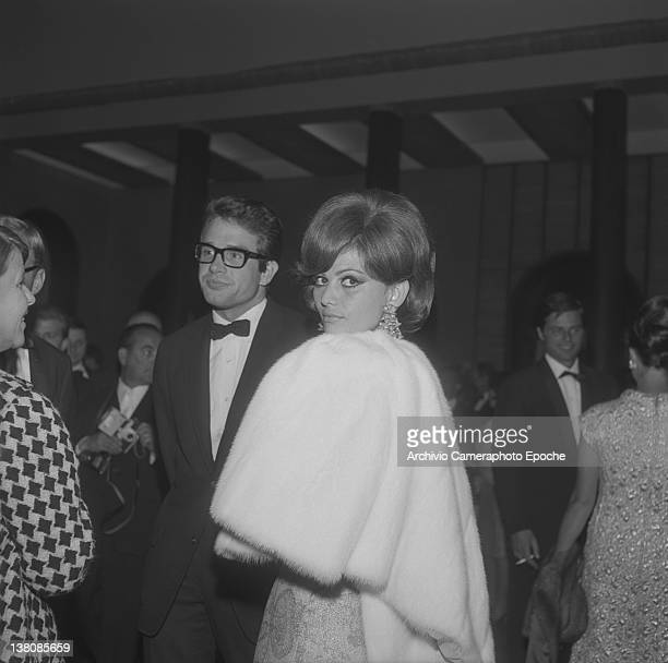 Italian actress Claudia Cardinale portrayed during a party with Warren Beatty and Jean Sorel in the background Venice 1965