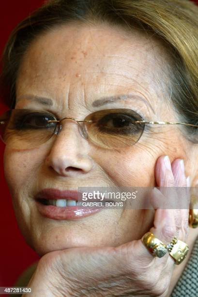 Italian actress Claudia Cardinale poses during a press conference 04 November 2002 in Rome to promote her first experience as theatre actress in...