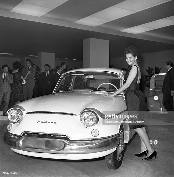 Italian actress Claudia Cardinale posing with a Panhard Italy 1960