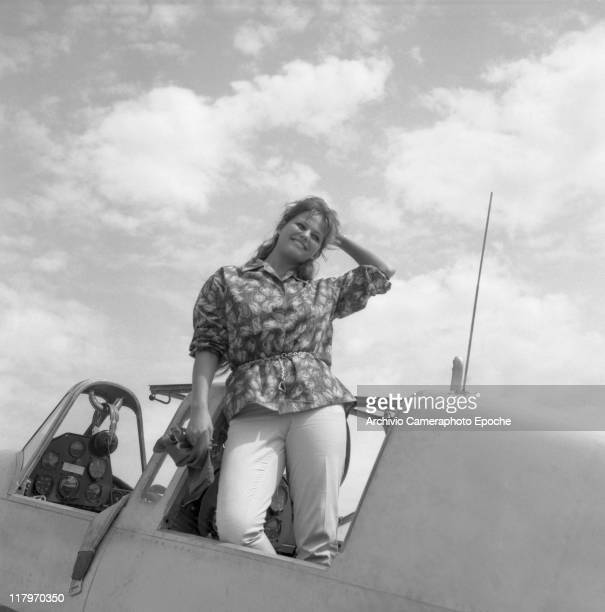 Italian actress Claudia Cardinale standing on an aircraft holding a foulard and smiling to the photographers at Nicelli airport S Nicoletto Lido...