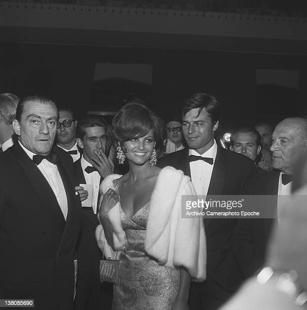 Italian actress Claudia Cardinale wearing a fur and prescious earrings portrayed during an evening party with Jean Sorel and Luchino Visconti Lido...