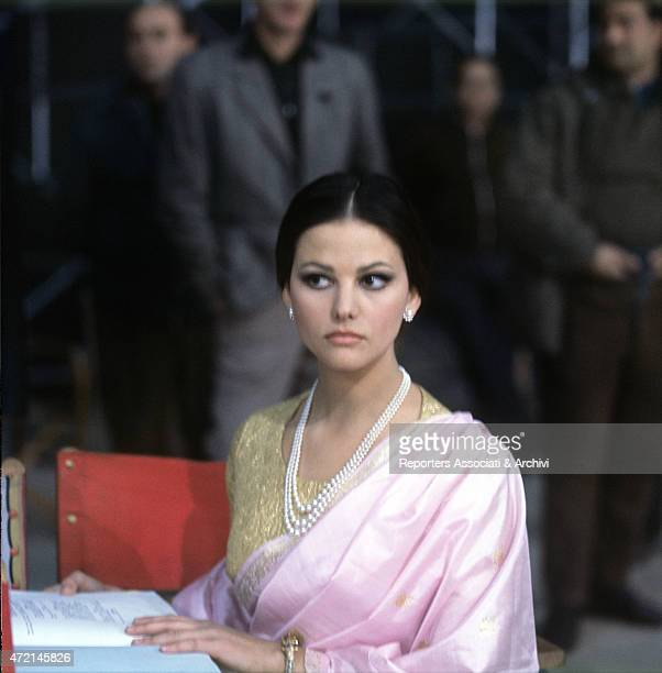 Italian actress Claudia Cardinale wearing the stage costume and revising the script before the shoot of a scene of the film 'The Pink Panther' 1963
