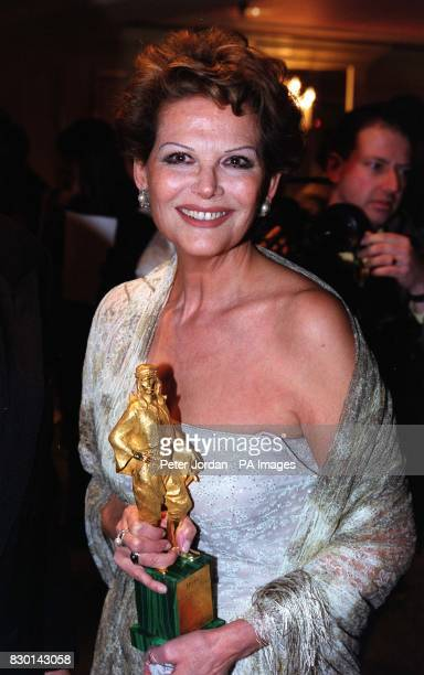 Italian actress Claudia Cardinale with her Rudolph Valentino Award for Lifetime's Achievement in Cinema at The Grosvenor House Hotel London The...
