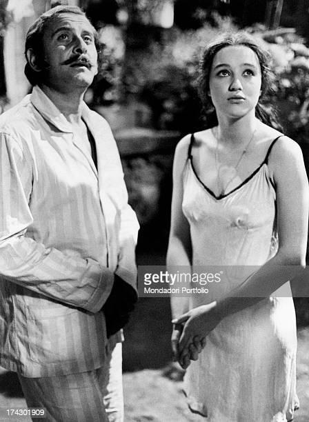Italian actress Eleonora Giorgi looking up with Italian singersongwriter and actor Domenico Modugno on the set of the film La sbandata Sant'Alfio 1974