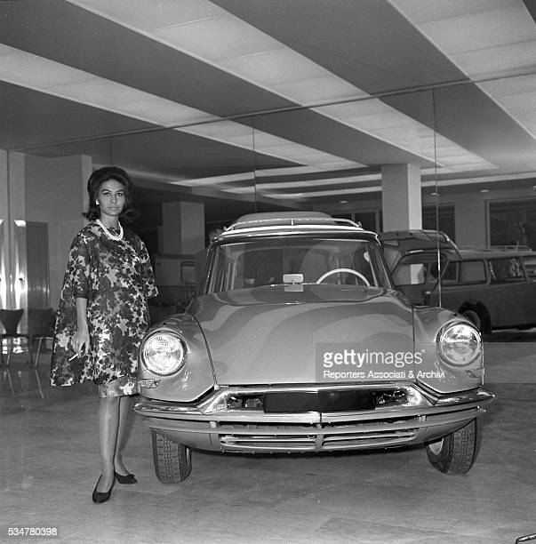 Italian actress Franca Bettoja posing in a car showroom Italy 1960
