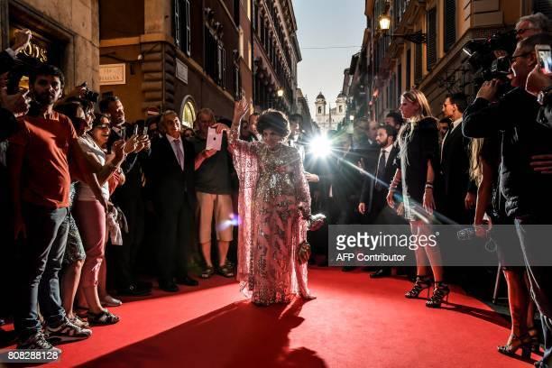 Italian actress Gina Lollobrigida arrives in Via Condotti to celebrates her 90th birthday on the red carpet in front of Piazza di Spagna in central...
