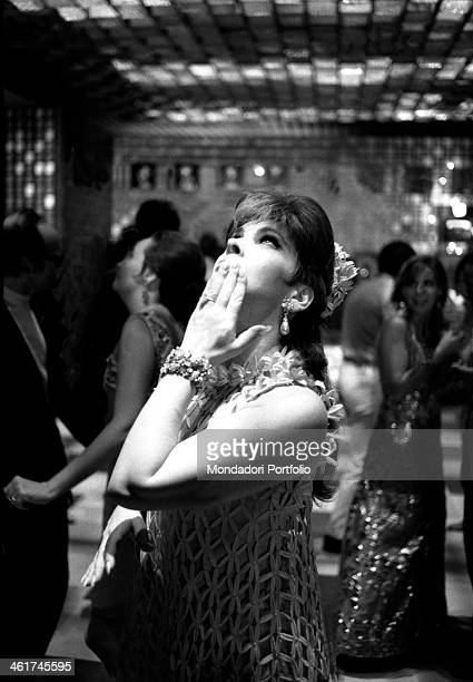 Italian actress Gina Lollobrigida looking up during the party in the halls of Ca' Vendramin Calergi offered by the Counts Cicogna to the participants...