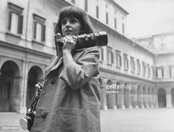Italian actress Gina Lollobrigida photographs the David di Donatello film awards at the Quirinal Palace in Rome Italy 12th March 1964